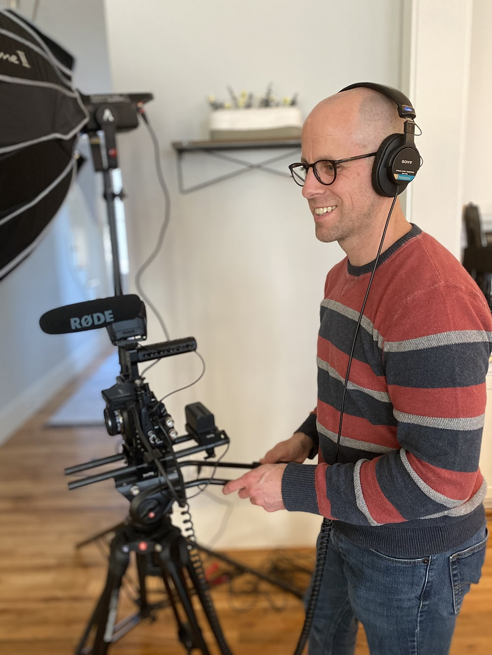 Jason, filming and wearing a pair of headphones