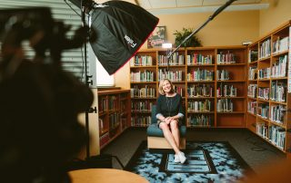 woman being filmed in a library
